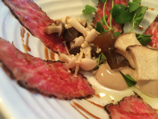 Indonesian Long Pepper Japanese Kobe Carpaccio, Pickled Shumeji and King Oyster Mushrooms, Porcini Foam, Bacon Dashi Gelée, Red Apple Balsamic Reduction