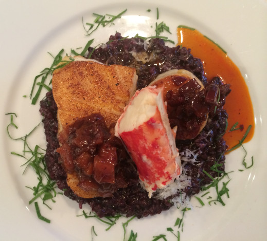 Sea Bass with Peach Chutney, King Crab, Seared Scallop with Chorizo Grapefruit Gastrique, Thai Black Rice Risotto